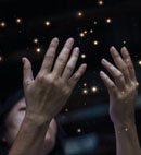 hands reaching up to the stars